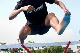 RUN FREE: Nabin Parajuli, 21, jumps over hurdles during his training. Hurdles are a component of the Steeplechase event.