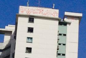 The graffiti which gave the residents of Toa Payoh a shock  on the morning of May 7.  We've pixelated over the area which has a vulgar four letter word.