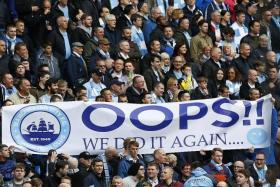 WE DID IT: Man City fans celebrating their league triumph yesterday.