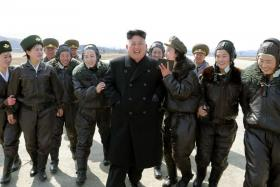 North Korean leader Kim Jong Un supervises a flight drill of the KPA Air and Anti-Air Force Unit 2620, honored with the Title of O Jung Hup-led 7th Regiment, in this undated photo released by North Korea's Korean Central News Agency (KCNA)