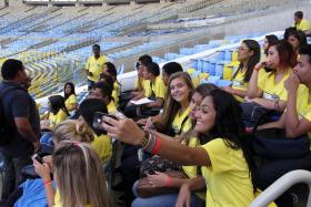 Tourists visit the Maracana stadium, one of the stadiums hosting the 2014 World Cup soccer matches, in Rio de Janeiro May 13, 2014.
