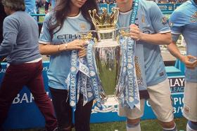 Atanes and Nasri pose with the Premier League trophy on Sunday
