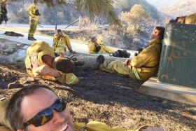 Firefighter's selfie goes viral after he battles San Diego wildfires