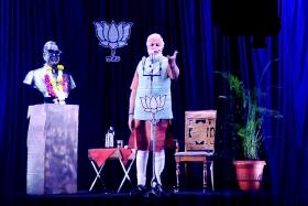 Narendra Modi appears at a telecast via a hologram image. He relied heavily on technology and social media to achieve a landslide victory at the recent Indian elections.