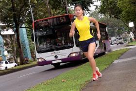 WOMAN VERSUS MACHINE: Paya Lebar Methodist Girls' School long-distance runner, Natalie Soh, chases buses as a form of training.