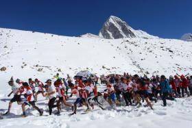 Marathon participants run at the start of the race at Gorapshep near Mount Everest Base camp in Nepal. The Tenzing-Hillary Everest Marathon, the world's highest marathon, starts near the Khumbu icefall at Everest Base Camp