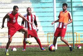 ON TARGET: Kamel Ramdani (left) is back after a lengthy knee injury and scored for Tanjong Pagar in their last game against Hougang United.