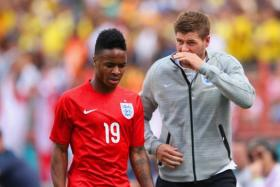 Steven Gerrard of England making sure that Raheem Sterling of England  is not walking alone as he does the walk of shame after he was shown a red card during the International friendly match between England and Ecuador at Sun Life