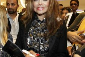 People magazine announced on Wednesday that singer La Toya Jackson is engaged to her business partner Jeffré Phillips.