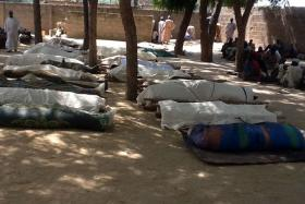 Dead bodies laid out for burial in the village of Konduga, in northeastern Nigeria, after a gruesome attack by Boko Haram Islamists killed 39 people in February 2014. Another attack on June 3 by suspected militants killed 400 villagers.