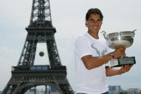 Nadal posing with the French Open title near the Eiffel Tower in Paris on Monday.