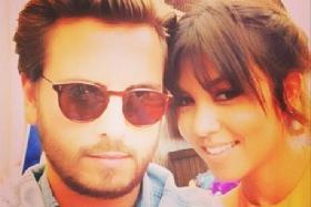 Kourtney Kardashian reveals that her third child with long-time boyfriend, Scott Disick, is on the way.