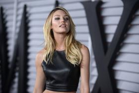 Candice Swanepoel strutted her stuff on the Maxim Hot 100 event red carpet after topping the Maxim Hot 100 chart beating out other babes like Irina Shayk, Jessica Alba, Mila Kunis and Cara Delevingne.