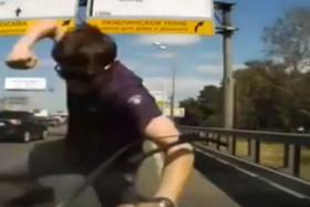 A man is caught on the dashboard camera punching the windscreen of a car. He also bent the windscreen wipers.