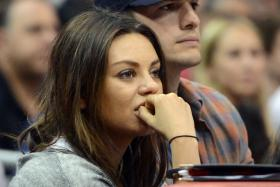 Ashton Kutcher and Mila Kunis will only tie the knot after baby arrives. Picture was taken at a basketball game between the Los Angeles Clippers and the Detroit Pistons at Staples Center.