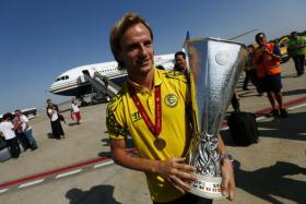 Sevilla's Ivan Rakitic, seen here holding the Europa League trophy, has agreed to join Barcelona on a five-year deal.