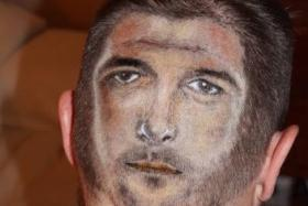 England fan Kai Ward decided to get an extreme haircut with Steven Gerrard's face shaved into the back of his head.  PHOTO: