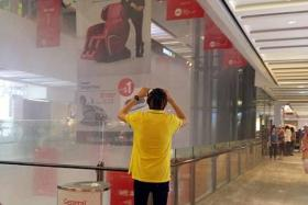 SOAKED: Shoppers at Jem were caught off-guard when a sprinkler system was suddenly activated.