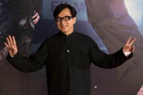 Hong Kong star actor Jackie Chan arrives at the 33rd Hong Kong Film Awards in Hong Kong on April 13, 2014. The annual awards are the Hong Kong equivalent to the Oscars and the British BAFTAS.
