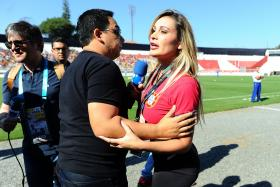 Ms Andressa Urach (centre), a former Miss BumBum pageant contestant who claimed to have slept with Cristiano Ronaldo, is escorted by members of security out of the grounds during a Portugal team training session in Sao Paulo on June 18. PHOTO: