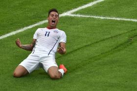 GOAL: Chile's forward Eduardo Vargas (above) celebrates after scoring their first goal in their 2-0 win over defending champions Spain.