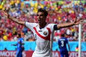 Costa Rica captain Bryan Ruiz celebrates after scoring against Italy in the World Cup.