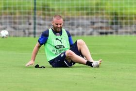 Daniele de Rossi, seen here in a photo from Italy's World Cup preparations, has been rated by team doctors as 'unlikely' to face Uruguay in their crucial Group D match.