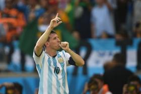 Lionel Messi celebrates after striking home the winner for Argentina against Iran.