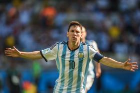 Argentine striker Lionel Messi celebrates his goal against Iran during their World Cup football match in Belo Horizonte, Brazil, on June 21, 2014. AFP