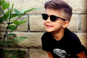 Ms Collette Wixom replicates the looks of high-end fashion models on her son with clothes from more affordable brands like H&M. Photo: