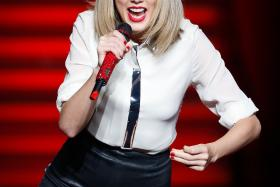 """US singer Taylor Swift is a """"middle-aged woman trapped in a 24-year-old's body"""", says English song-writer Ed Sheeran."""