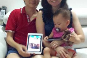 NEWS ON-THE-GO: Mr Tan Eng Sing and his wife Karen Foo showing the tablet that they use to read news on the TNP app.