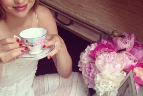 Aussie model Miranda Kerr was on Twitter to take questions. She was promoting teacups for Royal Albert on Wednesday.