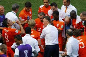 Louis van Gaal issues tactical instructions to his team team during a cooling break in their World Cup round of 16 clash against Mexico.