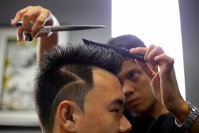 HAIR-RAISING: Mr Yap having his Cristiano Ronaldo-inspired cut.