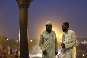 Muslims stand after having their Iftar (breaking of fast) meal on the first day of the holy month of Ramadan in India, at the Jama Masjid (Grand Mosque) in the old quarters of Delhi June 30, 2014. Photo: Reuters