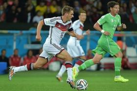 STRUGGLE: Germany play better when captain Philipp Lahm (above, in white) is deployed in his natural position as right back.