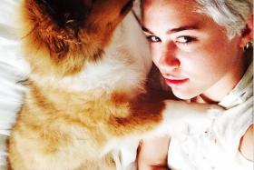 Miley Cyrus posted her first photo with new dog Emu on her Instagram account on June 28.
