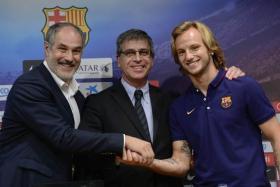 Barcelona new boy Ivan Rakitic (right) shakes hands with director Andoni Zubizaretta (centre) in front of club vice-president Jordi Mestre.