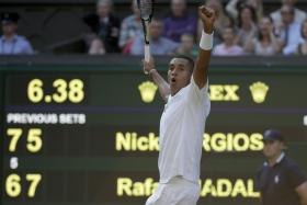 Nick Kyrgios of Australia reacts to winning the third set tie-break during his men's singles tennis match against Rafael Nadal of Spain at the Wimbledon Tennis Championships, in London July 1, 2014.  Photo: Reuters