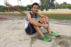 WINNING LEAP: Chan Zhe Ying of Catholic Junior College beat favourite Joshua Hia to win the triple jump gold with 13.71m.
