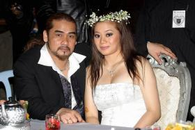Awie and wife Rozana Misbun during their wedding during happier times