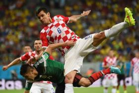 Croatia defender Dejan Lovren (right) has hit out at Southampton over a proposed transfer to Liverpool.
