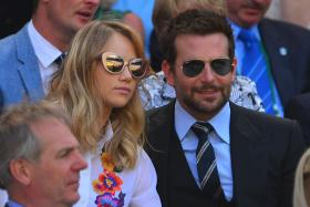 US actors Bradley Cooper and his girlfriend British model Suki Waterhouse sit in the Royal Box before the start of the men's singles semi-final match on day 11 of the 2014 Wimbledon Championships on July 4, 2014. Photo: AFP