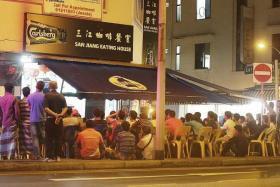 THEY GOT THE FEVER: Packed coffee shops in Geylang screening matches.