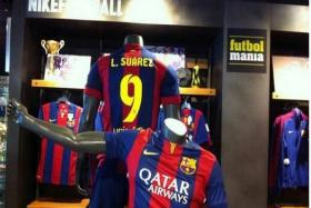 A sports store in Barcelona has already begun selling Suarez Barcelona jerseys despite no confirmation of the Liverpool player's transfer.