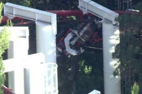 A derailed roller coaster car at a California amusement park left 22 riders stranded in midair for nearly three hours before they were rescued.