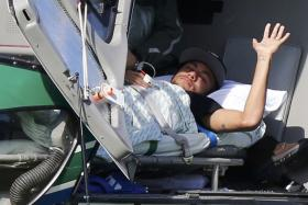 Injured Brazilian star Neymar waits to be airlifted home from Brazil's training camp in Teresopolis.
