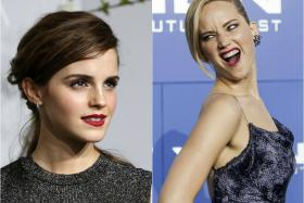 No she didn't! Jennifer Lawrence shoves her hand in Emma Watson's face at the Christian Dior fashion show in Paris on Monday.