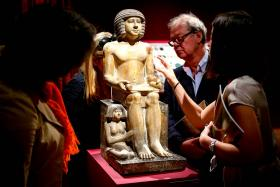 The Egyptian limestone statue of Sekhemka at Christie's auction house in London on June 13. The statue was sold for £15.76 million (S$33.5m).